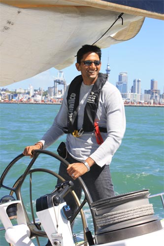 India's bowling coach Venkatesh Prasad steers the wheel, while enjoying sailing in Auckland, New Zealand's Harbour City.