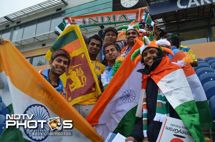 Indian and Sri Lankan fans pose for a photograph before the start of play.