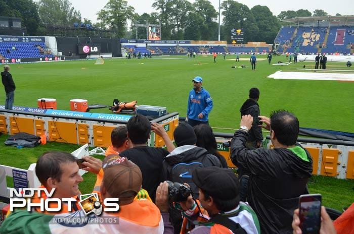 Ahead of the start of the semi-final, fans line up to get a closer glance at India skipper MS Dhoni as Team India warmed up on Thursday at the Sophia Gardens.