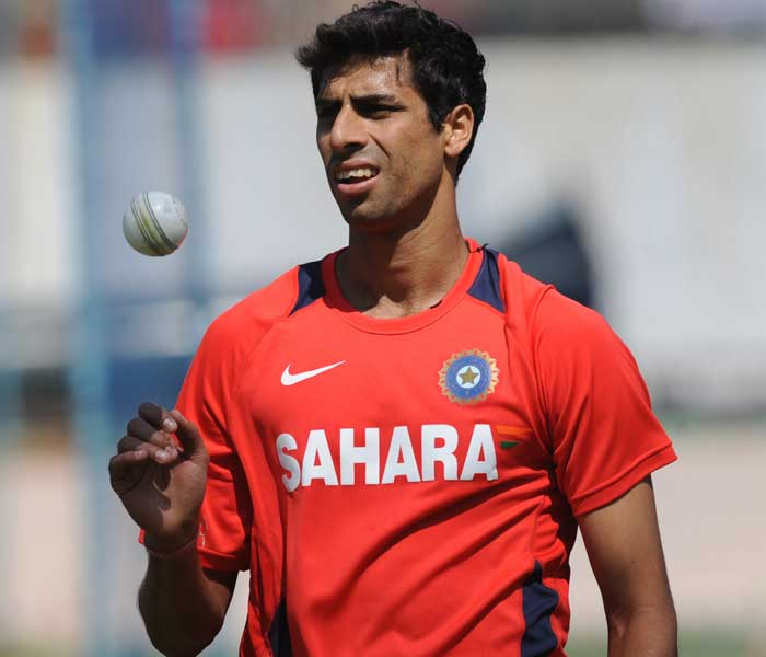 Ashish Nehra tosses the ball while bowling in the nets. (AFP Photo)