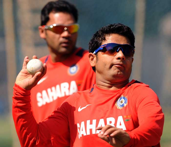 Piyush Chawla bowls during a training session. (AFP Photo)