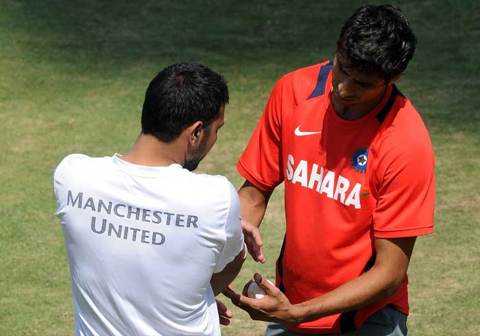India cricketer Ashish Nehra talks with Praveen Kumar who had bowed out of the tournament with an injury. (AFP Photo)