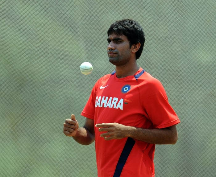 Indian bowler Munaf Patel tosses the ball in the nets during a training session. (AFP Photo)