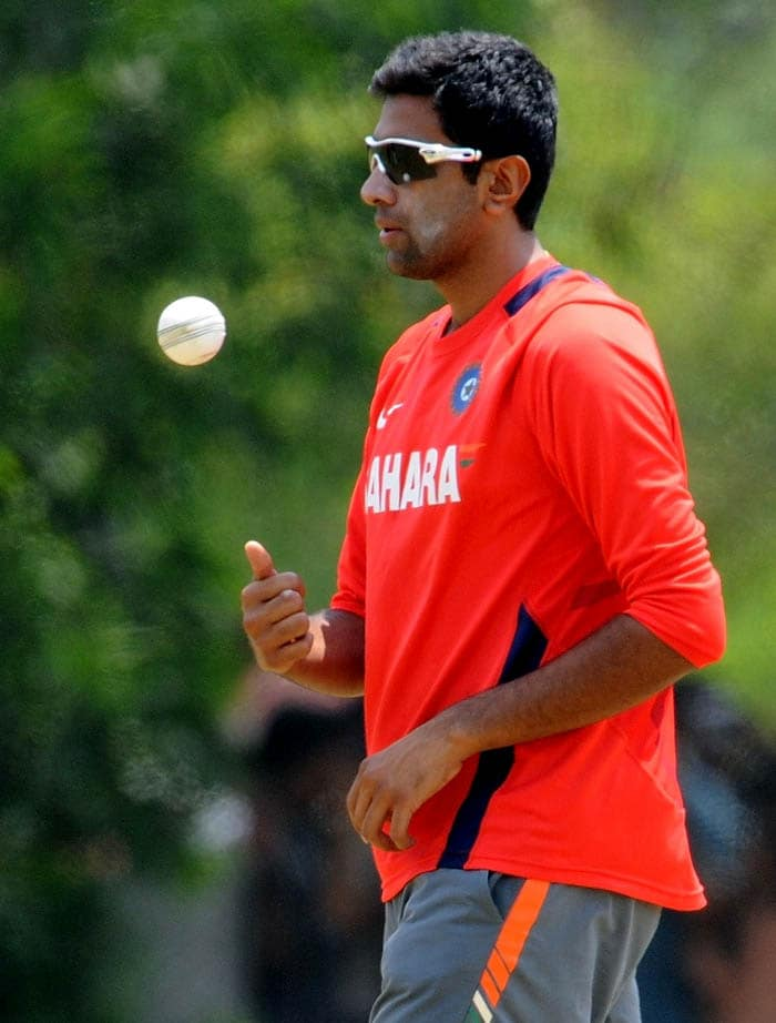 Indian bowler Ravichandran Ashwin tosses the ball while bowling in the nets. (AFP Photo)