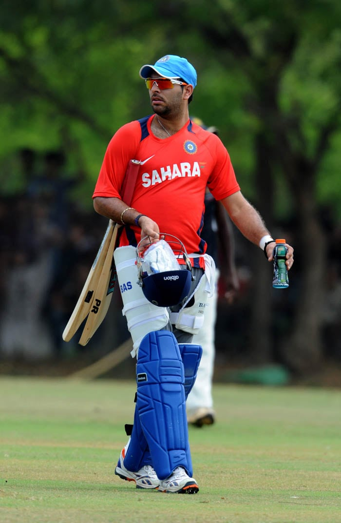 Indian batsman Yuvraj Singh arrives to bat in the nets during a training session. (AFP Photo)
