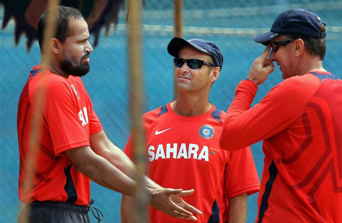 Indian cricketer Yusuf Pathan with coach Gary Kirsten during a practice session at the IIT Ground in Chennai. (PTI Photo)