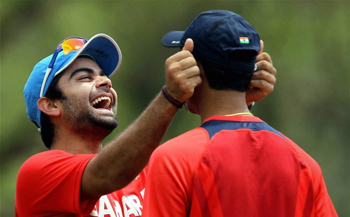 Indian cricketer Virat Kohli with teammate during a practice session at the IIT Ground in Chennai. (PTI Photo)