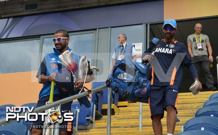 Dinesh Karthik and Shikhar Dhawan seem in a relaxed mood ahead of his training session in Cardiff.