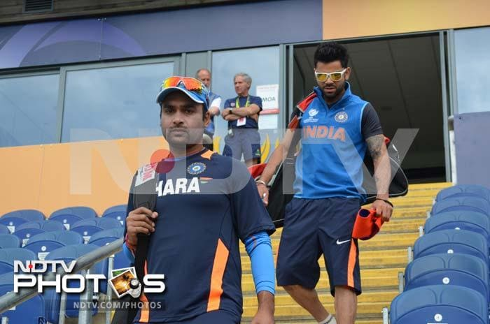 Amit Mishra arrives for training with a serious expression on his face.