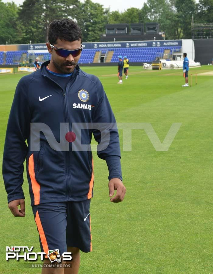 Ravindra Jadeja takes a bit of a breather as his mates have a go at training.