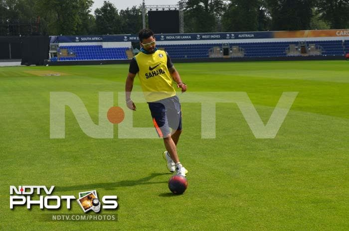 Virat Kohli has a go at the football to keep himself fit for the game.