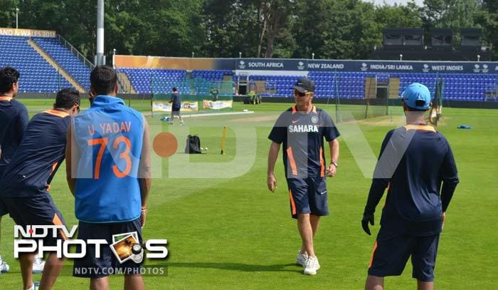 Trevor Penny makes a point during India's fielding practice at Cardiff.