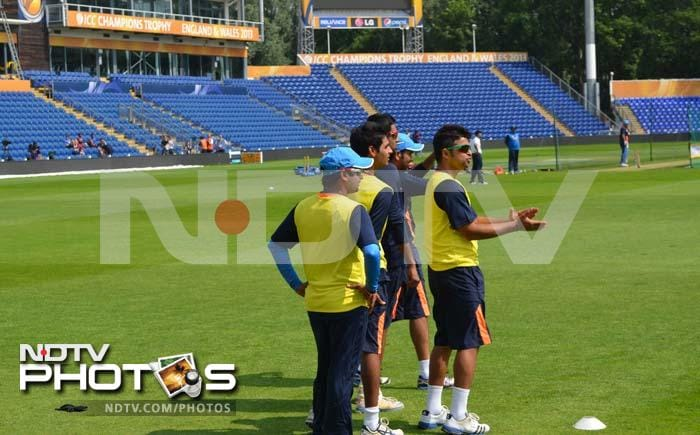 Suresh Raina cheers his mates on as they train at the stadium in Cardiff.
