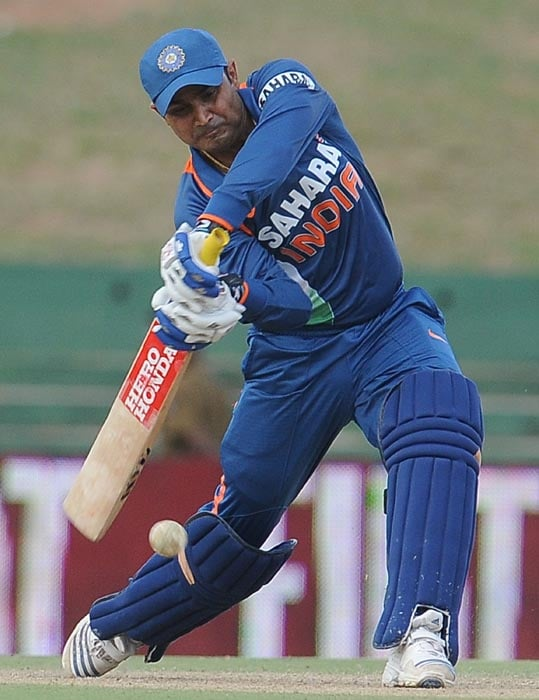 Indian cricketer Virender Sehwag plays a shot during the sixth ODI of the Micromax tri-series between India and New Zealand at the Rangiri Dambulla International stadium in Dambulla. (AFP Photo)