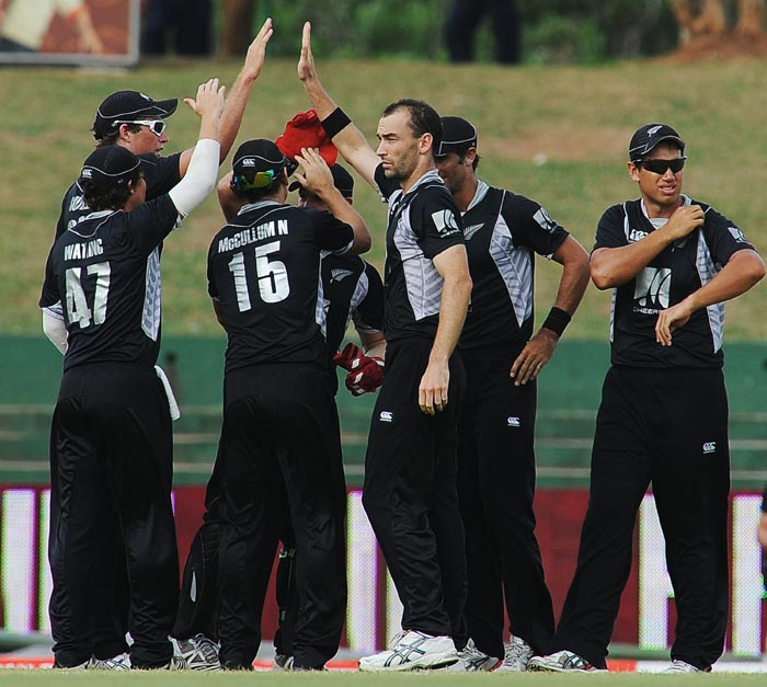 New Zealand cricketer Andy McKay celebrates teammates after the dismissal of Indian cricketer Yuvraj Singh during the sixth ODI of the Micromax tri-series between India and New Zealand at the Rangiri Dambulla International stadium in Dambulla. (AFP Photo)