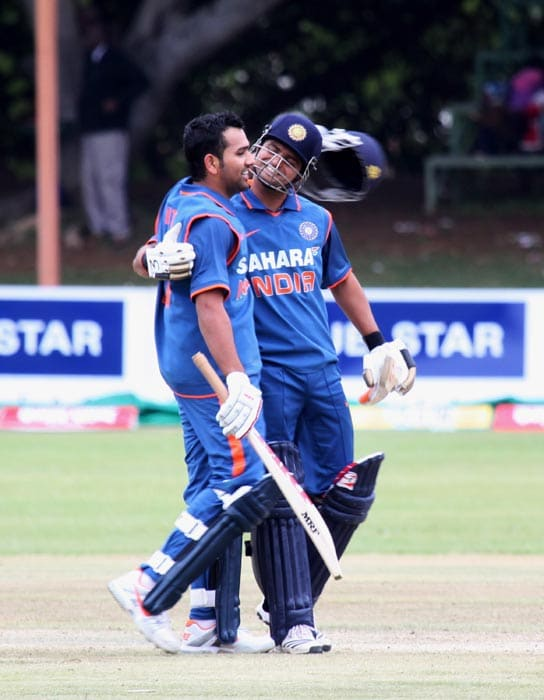 Indian skipper Suresh Raina celebrates with Rohit Sharma after India beat Sri Lanka by 7 wickets in the second match of the Micromax Cup Triangular One-Day International series at Queens Sports club in Bulawayo . (AP Photo)