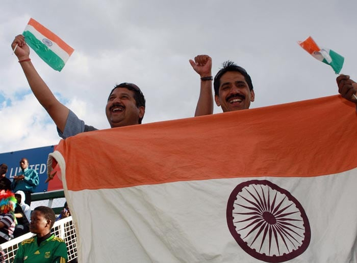 Indian team supporters celebrate after their team's victory against Zimbabwe at Harare Sports Club in the second and last of the two Micromax Twenty 20 series. India won the series by 7 wickets. (AFP Photo)