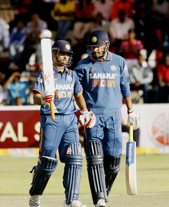 Indian captain Suresh Raina celebrates with his team mate Yusuf Pathan after reaching his half century at Harare Sports Club in the second and last of the two Micromax Twenty 20 series. India won the series by 7 wickets. (AFP Photo)