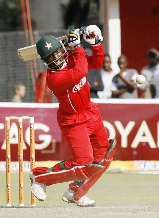 Zimbabwean Batsman Tatenda Taibu plays a shot from Indian bowler Pragyan Ojha at Harare Sports Club in the second and last of the two Micromax Twenty 20 series. India won the series by 7 wickets. (AFP Photo)
