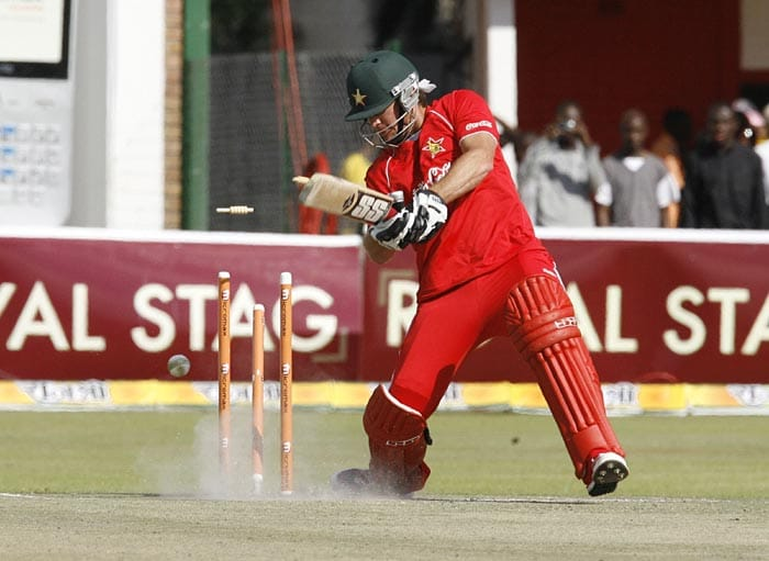 Zimbabwean batsman Charles Coventry is clean bowled by Ashok Dinda at Harare Sports Club in the second and last of the two Micromax Twenty 20 series. India won the series by 7 wickets. (AFP Photo)