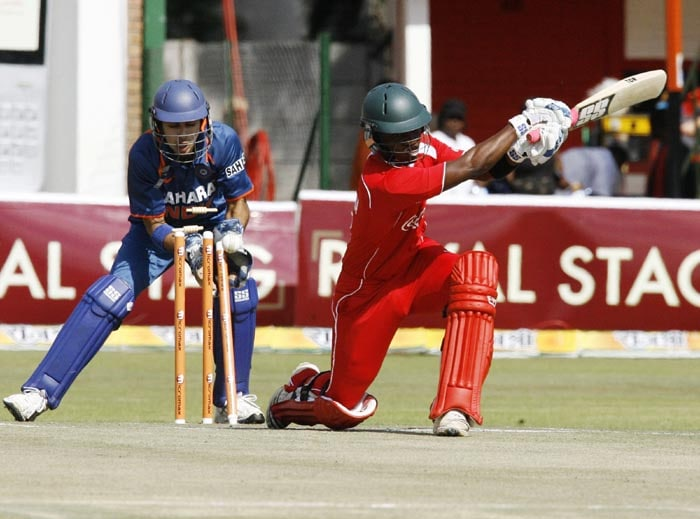 Zimbabwean batsman Chamunorwa Chibhabha loses his stumps off Pragyan Ojha's bowling at Harare Sports Club in the second and last of the two Micromax Twenty 20 series. India won the series by 7 wickets. (AFP Photo)