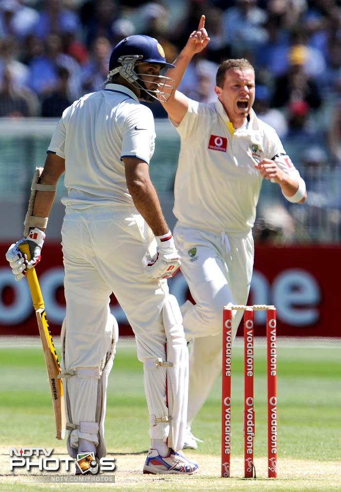 Indian batsman VVS Laxman looks back to see he is caught behind off the bowling of Australian paceman Peter Siddle on Day 3 of the first Test match at the Melbourne Cricket Ground in Melbourne. (AFP Photo)