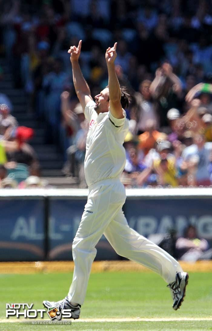 Australian paceman Ben Hilfenhaus celebrates as he takes five Indian wickets on Day 3 of the first Test match at the Melbourne Cricket Ground in Melbourne. (AFP Photo)