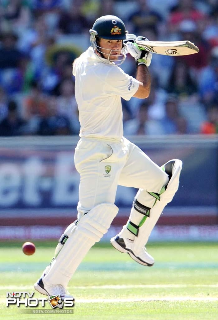 Australian batsman Ricky Ponting cuts a ball away on Day 3 of their first Test match against India at the Melbourne Cricket Ground in Melbourne. (AFP Photo)