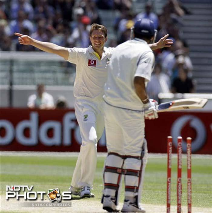 James Pattinson of Australia celebrates after claiming the wicket of Zaheer Khan of India during Day 3 of their first Test match at the Melbourne Cricket Ground in Melbourne. (AP Photo)