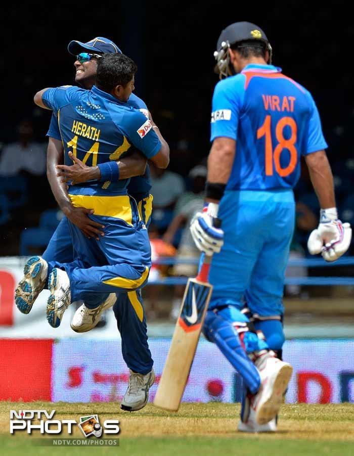 But Kohli was soon to depart, after being trapped plumb leg-before wicket by Rangana Herath.