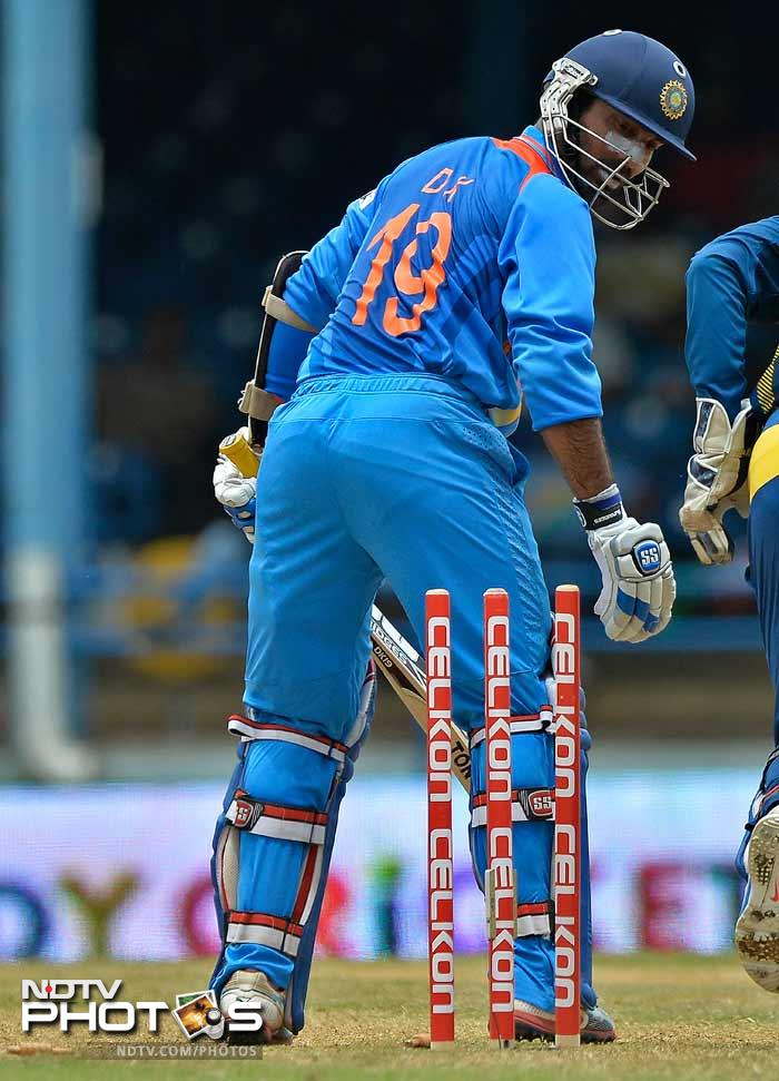 Dinesh Karthik, though aggressive, didn't last long as he was bowled for 12 by Herath.