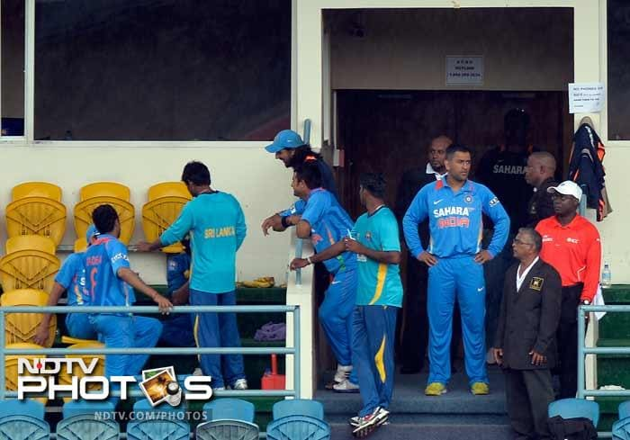 Opposition players were seen in a jovial mood in the dressing room as they waited for the showers to subside. MS Dhoni too found time to stretch his arms.