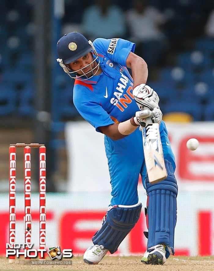Rohit Sharma fought hard for India and was unbeaten on 48 before rain brought an end to the Indian innings.