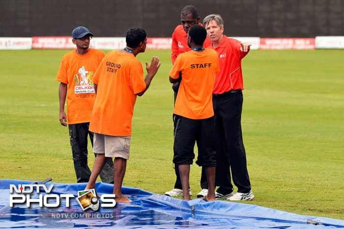 After a lot of discussion the umpires decided that Sri Lanka would have to chase 178 in 26 overs under the D/L method.