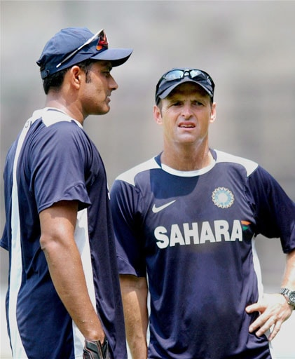 Indian skipper Anil Kumble with coach Gary Kirsten during a training session ahead of the Australian series at Chinnaswamy Stadium in Bangalore. (PTI Photo)