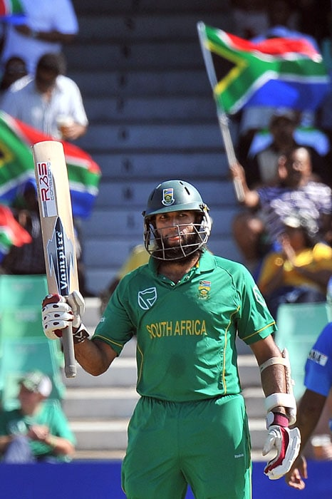 South Africa's Hashim Amla celebrates 50 runs during the first One Day International between India and South Africa at Kingsmead Stadium in Durban. (AFP Photo)