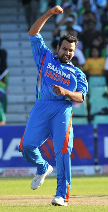 Indian Rohit Sharma celebrates dismissing South African Jean-Paul Duminy for 76 runs during the first One Day International between India and South Africa at Kingsmead Stadium in Durban. (AFP Photo)