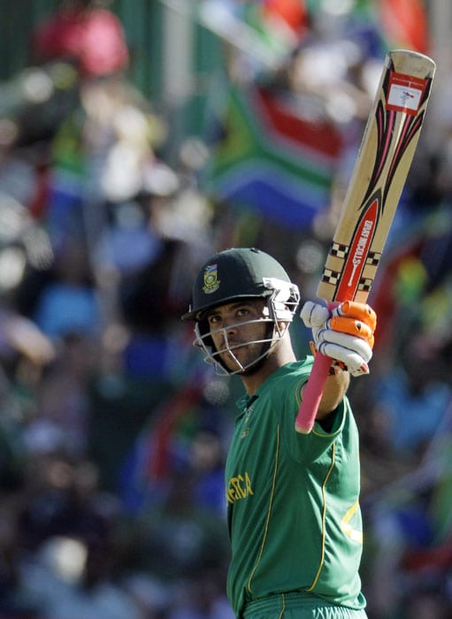 South Africa's batsman Jean-Paul Duminy celebrates his half century during the first One Day International between India and South Africa at Kingsmead Stadium in Durban. (AP Photo)