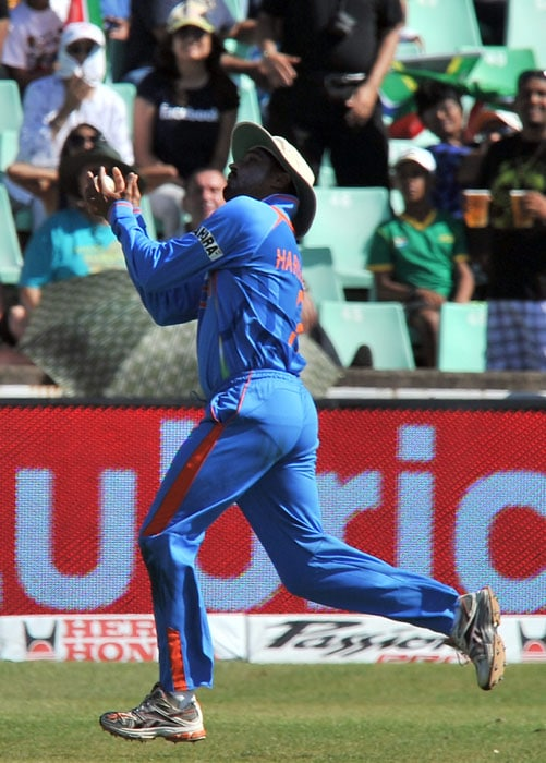 Indian Harbhajan Singh catches out South Africa's Hashim Amla for 50 runs during the first One Day International between India and South Africa at Kingsmead Stadium in Durban. (AFP Photo)