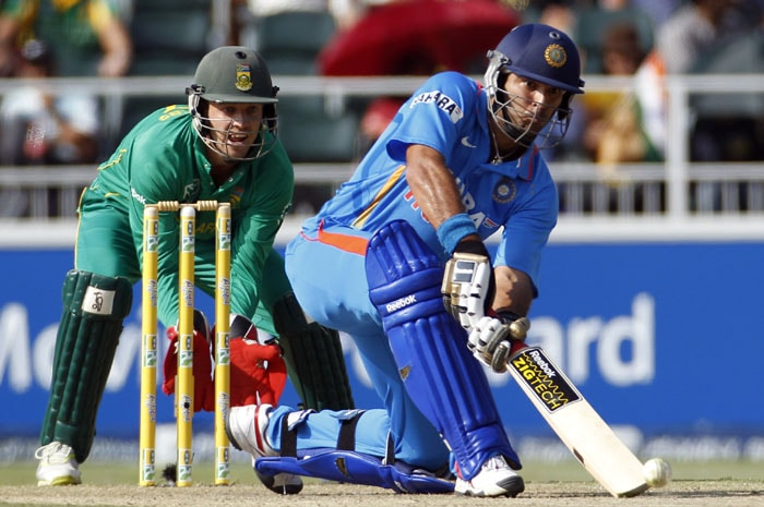 India's batsman Yuvraj Singh, plays a shot as South Africa's wicketkeeper Abraham Benjamin de Villiers, looks on during the second One Day International cricket match against South Africa at the Wanderers stadium, Johannesburg. (AP Photo)