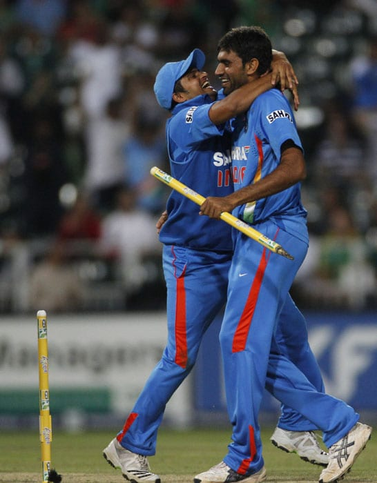 India's bowler Munaf Patel, celebrates with fellow team member Suresh Raina, after taking the winning wicket of South Africa's batsman Wayne Parnell, during the second One Day International cricket match at the Wanderers stadium in Johannesburg. (AP Photo)