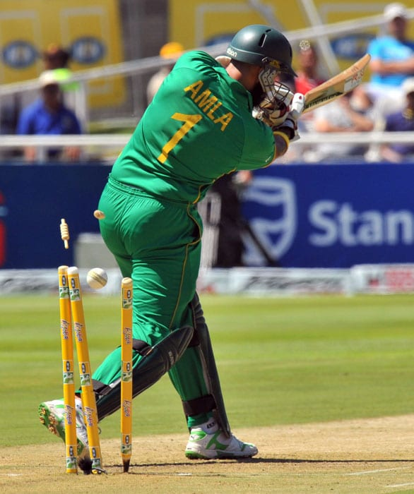 South African batsman Hashim Amla is clean bowled by Indian Zaheer Khan during the third one day International played against South Africa in Cape Town, South Africa. (AFP Photo)