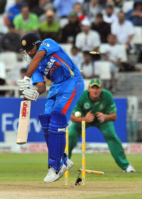 Indian Rohit Sharma is clean bowled by South African Morne Morkel for 23 runs during the third one day International played against South Africa in Cape Town, South Africa. (AFP Photo)