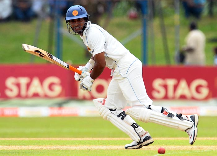 Sri Lankan cricket captain Kumar Sangakkara plays a stroke during the first day of the third Test match between Sri Lanka and India at the P. Sara Oval International Cricket Stadium in Colombo. (AFP Photo)