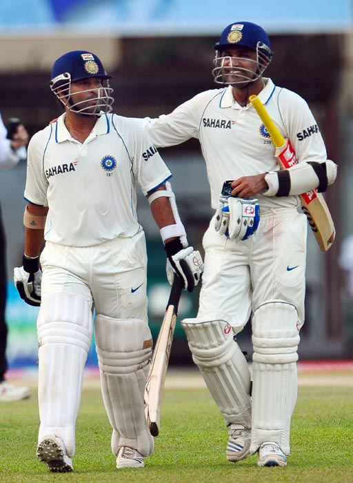 Indian cricketer Sachin Tendulkar and teammate Virender Sehwag walk off the pitch at the end of play on the second day of the third Test match between Sri Lanka and India at The P. Sara Oval International Cricket Stadium in Colombo. (AFP Photo)