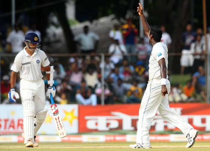 Sri Lankan cricketer Anjelo Mathews celebrates the dismissal of Indian batsman Rahul Dravid during the second day of the third Test match between Sri Lanka and India at The P. Sara Oval International Cricket Stadium in Colombo. (AFP Photo)