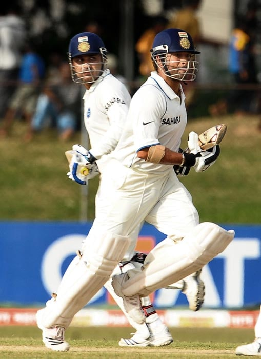 Indian cricketer Sachin Tendulkar and teammate Virender Sehwag run between the wickets during the second day of the third Test match between Sri Lanka and India at The P. Sara Oval International Cricket Stadium in Colombo. (AFP Photo)