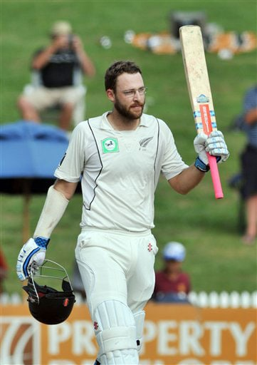 Daniel Vettori salutes the crowd after his century against India on Day 1 of the first Test at Seddon Park in Hamilton. (AP Photo)