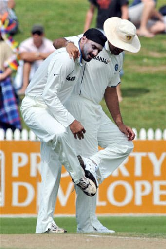 Harbhajan Singh and Zaheer Singh are seen in a spike cleaning ritual dance against New Zealand on Day 1 of the first Test at Seddon Park in Hamilton. (AP Photo)