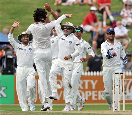 Ishant Sharma celebrates with Virender Sehwag after taking the wicket of James Franklin on Day 1 of the first Test at Seddon Park in Hamilton. (AP Photo)